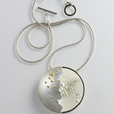 Morphology Pendant I. Large pendant, sterling silver with 18 carat gold granulation, £540.