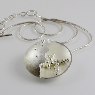 Morphology Pendant II. Large pendant, sterling silver with granulation detail, £600.