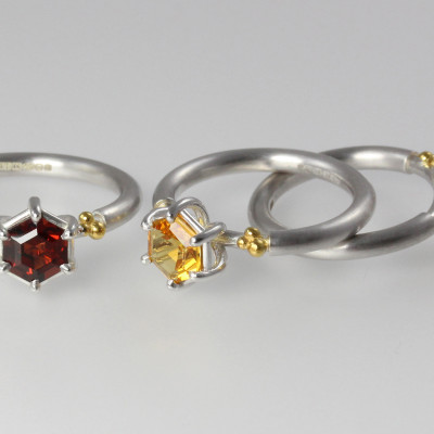 Morphology Rings. Sterling silver with hexagonal cut garnets and citrines and 22ct gold plate, £350.