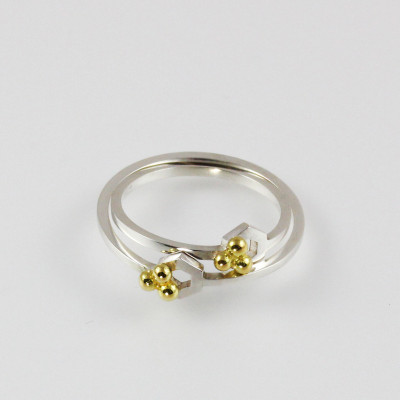 Isometric Rings. Sterling silver and 18 carat gold, £80.