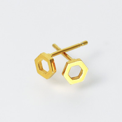Isometric Studs I. Tiny stud earrings, sterling silver plated with 22ct gold, £65.