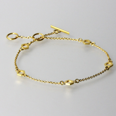 Isometric Bracelet. Fine chain bracelet, sterling silver plated in 22ct gold, £110.