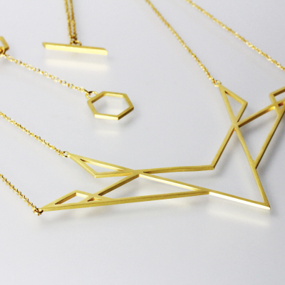 Isometric Necklace I. Double chain necklace, sterling silver plated with 22ct gold, £300.