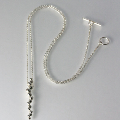 Morphology Pendant VII. Sterling silver, £115. Optional extra-long chain, £125.