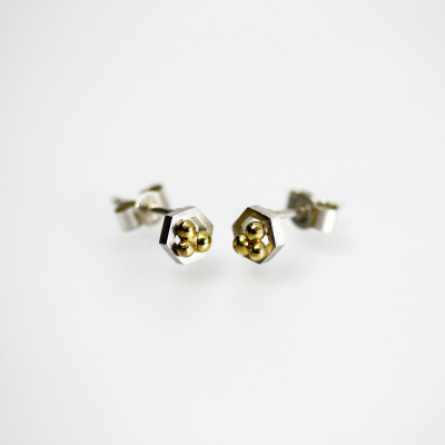 Isometric Studs II. Tiny stud earrings, sterling silver and 18 carat gold, £115.