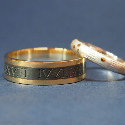 Sterling silver and 18ct gold pair of 'celestial' wedding rings. One etched with astrolabe markings and the co-ordinates of the marriage ceremony, the other studded with gold in the formation of stars visible along the galactic plane on the date of the wedding.