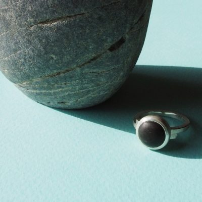 Sterling silver overlap ring featuring a large cabochon cut from a beach pebble. February 2017