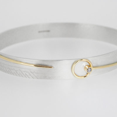 Cassini Bangle. Etched bangle, sterling silver and 9ct gold with smoky grey diamond. £850