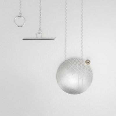 Kopra Pendant - Light. Etched pendant, sterling silver and 9ct gold with smoky grey diamond. £400