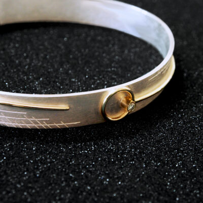 Sterling silver, 9ct gold, smoky grey diamond. Hand etched.